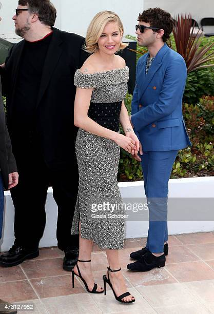 Jury members Guillermo Del Toro Sienna Miller and Xavier Dolan attend the Jury photocall during the 68th annual Cannes Film Festival on May 13 2015...