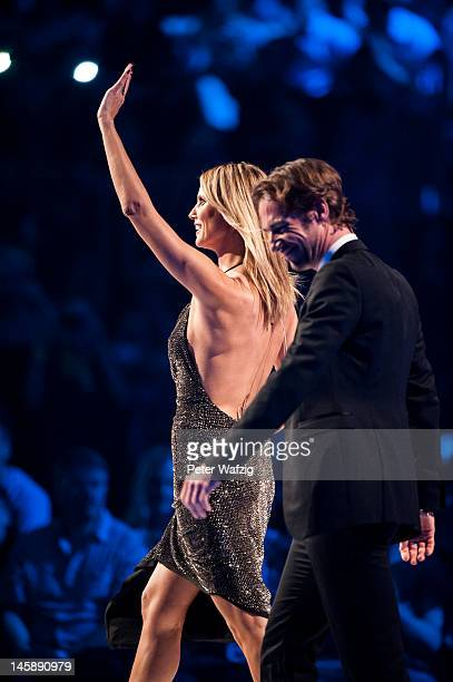 Jury members Heidi Klum and Thomas Hayo during the Germany's Next Topmodel Finals at the LanxessArena on June 07 2012 in Cologne Germany
