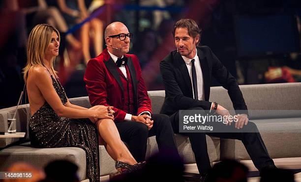 Jury members Heidi Klum Thomas Rath and Thomas Hayo during the Germany's Next Topmodel Finals at the LanxessArena on June 07 2012 in Cologne Germany