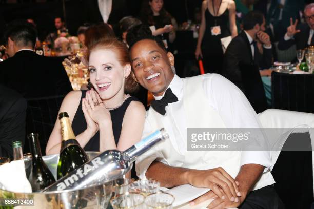 Jury members Jessica Chastain and Will Smith attend the amfAR Gala Cannes 2017 at Hotel du CapEdenRoc on May 25 2017 in Cap d'Antibes France