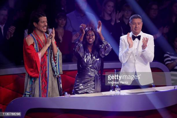 Jury members Jorge Gonzalez Motsi Mabuse and Joachim Llambi applaud during the preshow Wer tanzt mit wem Die grosse Kennenlernshow of the television...