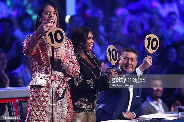 Jury members Jorge Gonzalez Motsi Mabuse and Joachim Llambi show their ratings during the 3rd show of the television competition 'Let's Dance' on...