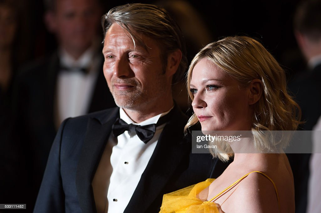 Jury members Kirsten Dunst (R) and Mads Mikkelsen (L) attend 'The Neon Demon' Premiere during the 69th annual Cannes Film Festival at the Palais des Festivals on May 20, 2016 in Cannes, France.