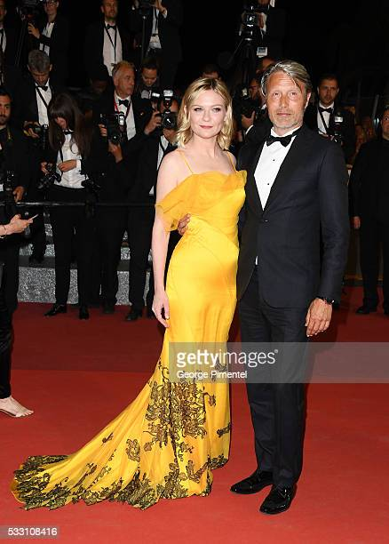 Jury members Kirsten Dunst and Mads Mikkelsen attends the 'Neon Demon' premiere during the 69th annual Cannes Film Festival at the Palais des...