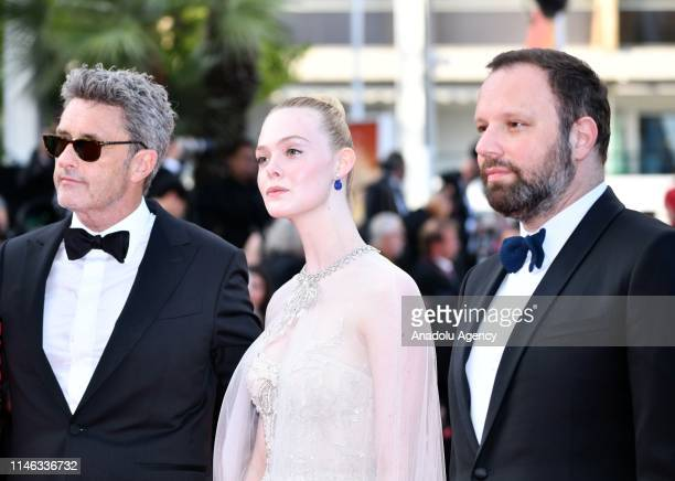 Jury Members of the main competition Pawel Pawlikowski Elle Fanning and Yorgos Lanthimos arrive for the Closing Awards Ceremony of the 72nd annual...