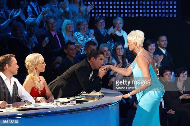 Jury members Peter Kraus Isabel Edvardsson watch Joachim Llambi kissing Brigitte Nielsen's hand during the 'Let's Dance' TV show at Studios Adlershof...