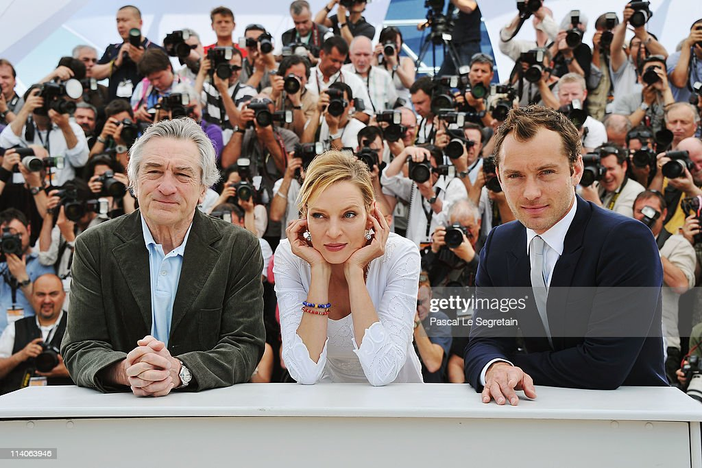 Jury members Robert De Niro, Uma Thurman and Jude Law attend the Jury Photocall at the Palais des Festivals during the 64th Cannes Film Festival on May 11, 2011 in Cannes, France.