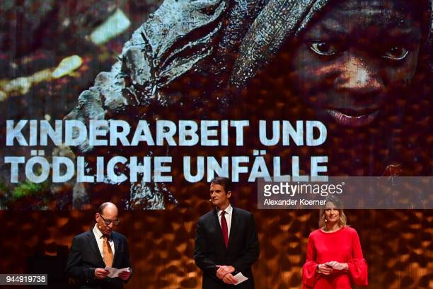 Jury members Ruediger Dietz Klaus Brinkbaeumer and Anja Reschke speak on stage at the Nannen Award 2018 at Elbphilharmonie on April 11 2018 in...