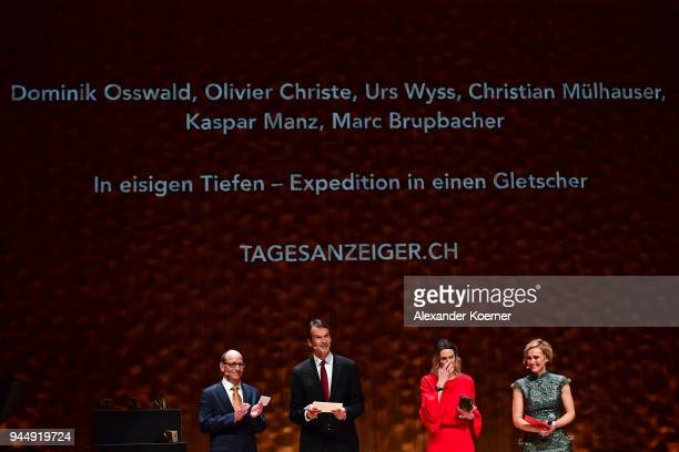 Jury members Ruediger Dietz Klaus Brinkbaeumer Anja Reschke and host Caren Miosga speak on stage at the Nannen Award 2018 at Elbphilharmonie on April...