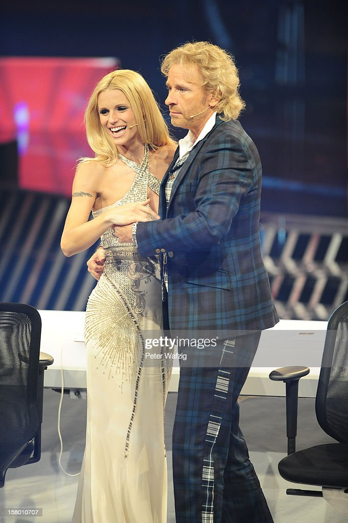 Jury members Thomas Gottschalk and Michelle Hunziker dance during the 'Das Supertalent' Semi Finals on December 08, 2012 in Cologne, Germany.