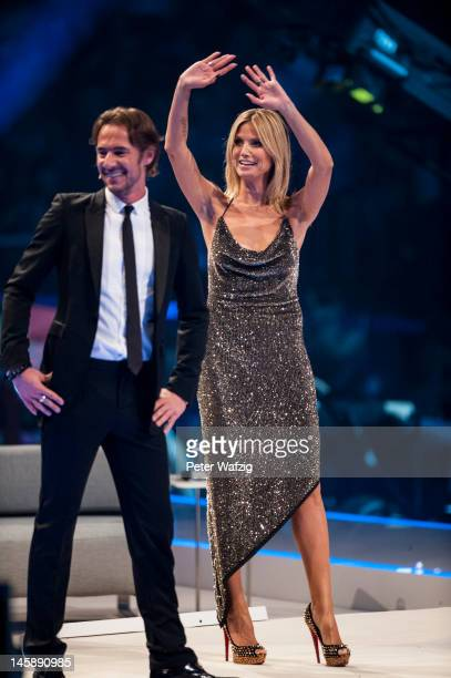 Jury members Thomas Hayo and Heidi Klum during the Germany's Next Topmodel Finals at the LanxessArena on June 07 2012 in Cologne Germany