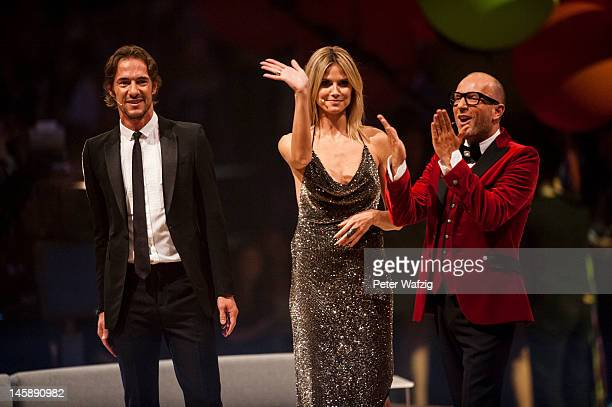 Jury members Thomas Hayo Heidi Klum and Thomas Rath during the Germany's Next Topmodel Finals at the LanxessArena on June 07 2012 in Cologne Germany