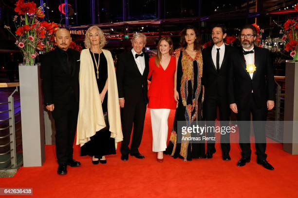 Jury members Wang Quan'an Dora Bouchoucha Fourati Paul Verhoeven Julia Jentsch Maggie Gyllenhaal Diego Luna and Olafur Eliasson arrive for the...