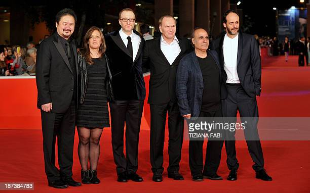 Jury members Zhang Yuan Noemie Lvovsky Jury President James Gray Aleksei Guskov Amir Naderi and Luca Guadagnino pose during the opening ceremony of...