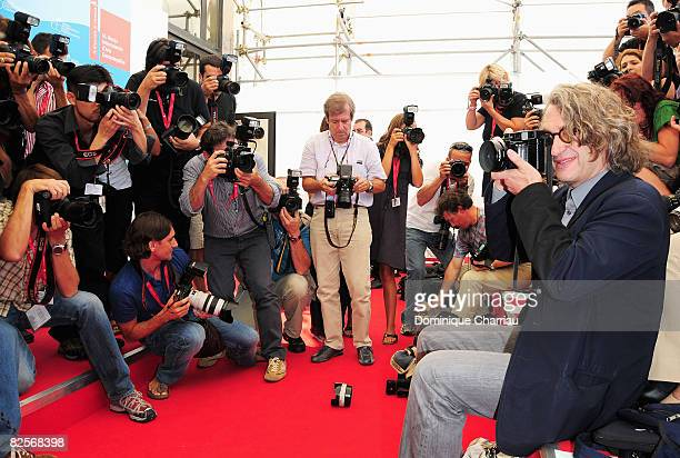 Jury President and Director Wim Wenders jokes with the photographers while attending the Presentation of the Venezia 65 Jury Photocall during the...