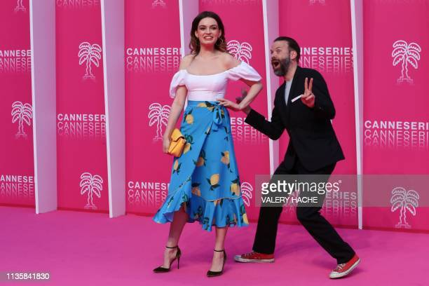 Jury president Baran bo Odar and jury member Emma Mackey share a joke as they pose for a photo call during the 2019 Cannes International Series...