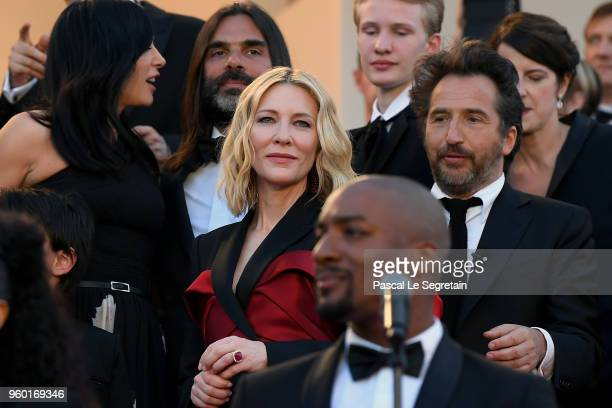 Jury president Cate Blanchett looks on as Sting and Shaggy perform on the red carpet steps during the 71st annual Cannes Film Festival at Palais des...
