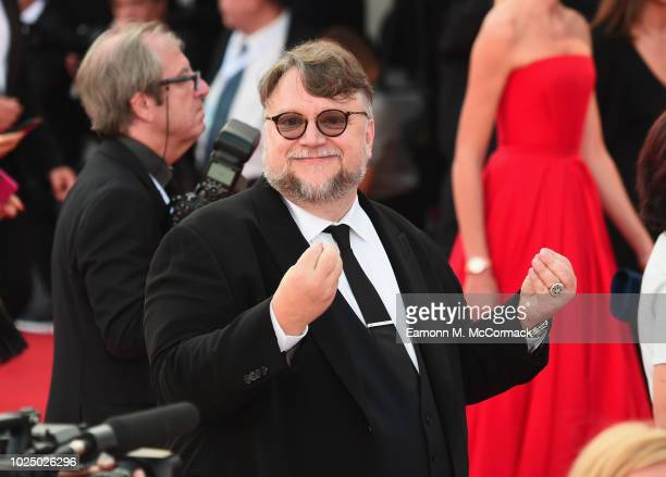 Jury President Guillermo Del Toro walks the red carpet ahead of the opening ceremony and the 'First Man' screening during the 75th Venice Film...