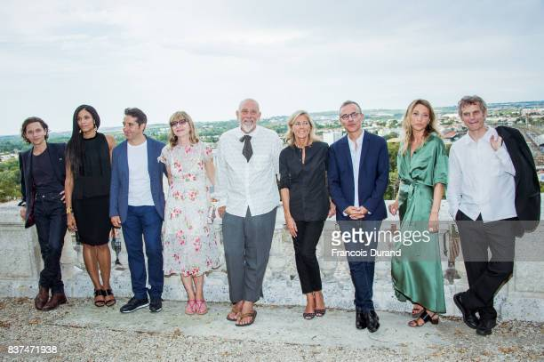 Jury president US actor and director John Malkovich poses with jury members French singer Raphael French actress Stefi Celma Canal Plus Cinema...