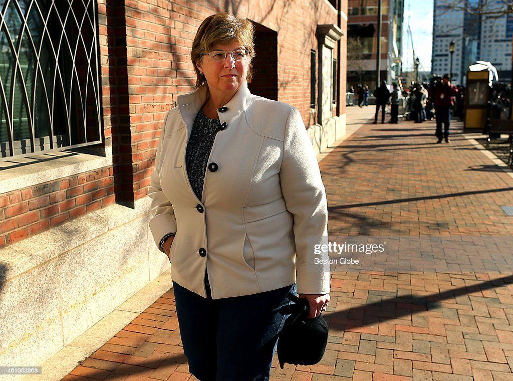 Jury selection for the trial of the Boston Marathon bomber started on January 5, 2015 at Moakley Federal Court. Karen Brassard, a victim of the bombing, leaves the courthouse after sitting through the morning session.