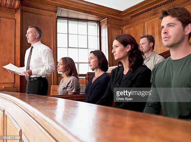 jury sitting in courtroom - juror law stock pictures, royalty-free photos & images