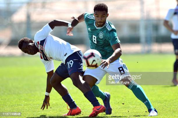 Jushua Kitolano of Norway and Manuel Mbom of Germany compete for the ball during the UEFA Elite Round match between Norway U19 and Germany U19 at...