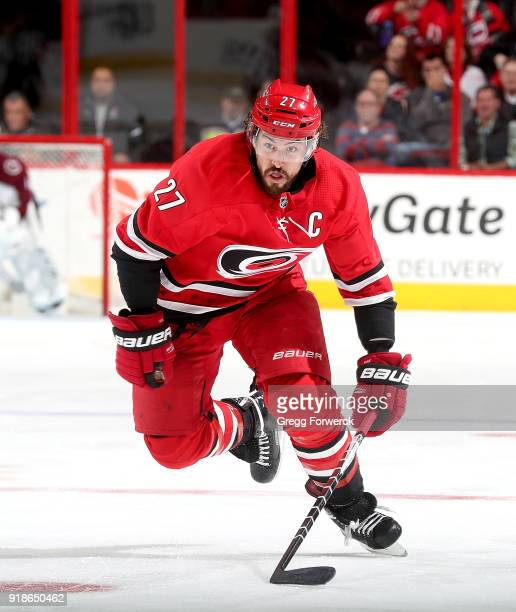 Jusitn Faulk of the Carolina Hurricanes skates for position on the ice during an NHL game against the Colorado Avalanche on February 10 2018 at PNC...