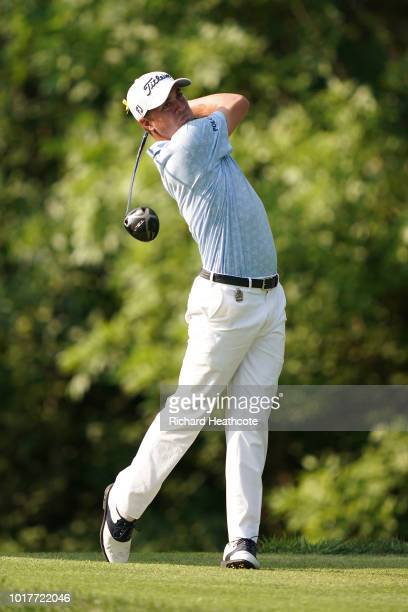 Jusrin Thomas of the USA hits driver from the 17th tee during the third round of the 2018 PGA Championship at Bellerive Country Club on August 11...