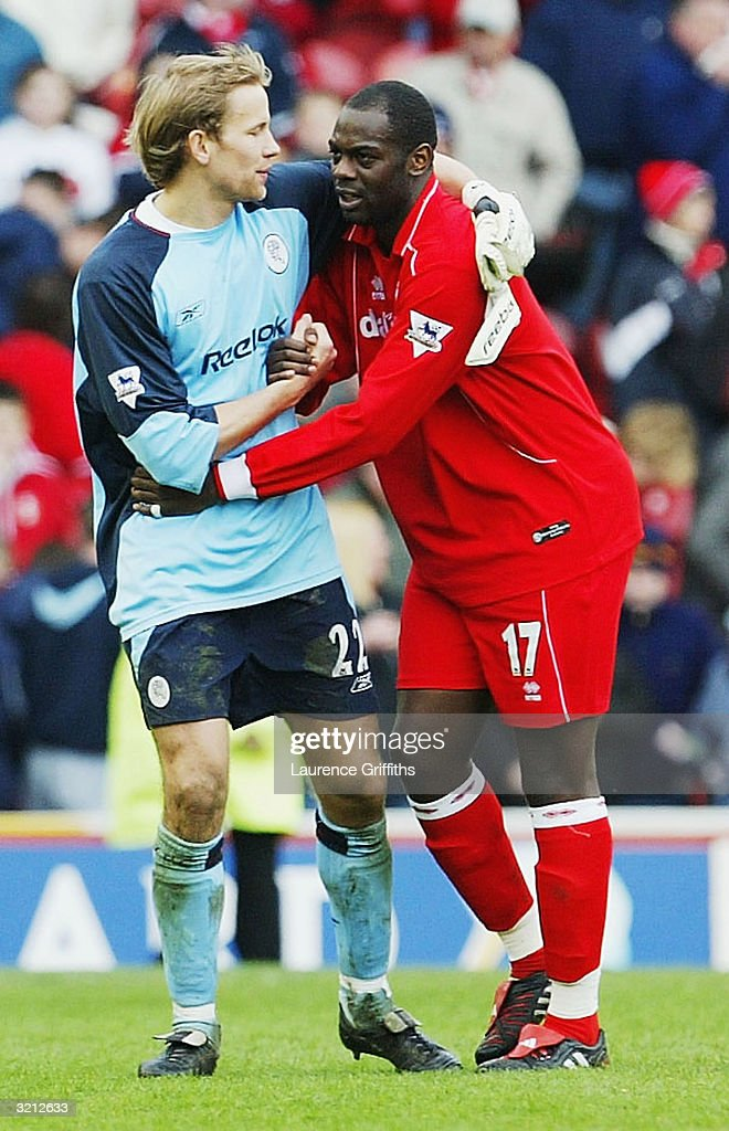 Jussi Jaaskelainen of Bolton congratulates his old team mate Michael Ricketts of Boro during the FA Barclaycard Premiership match between Middlesbrough and Bolton Wanderers at The Riverside Stadium on April 3, 2004 in Middlesbrough, England.