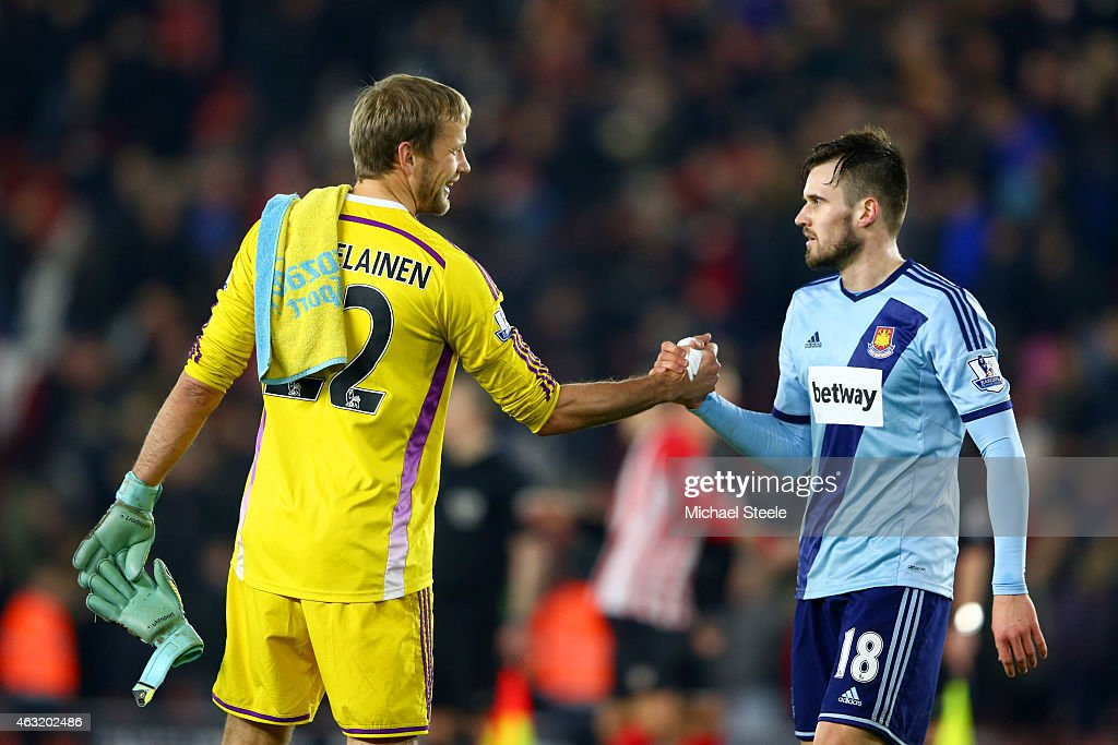 Jussi Jaaskelainen of West Ham shakes hands with team-mate Carl Jenkinson after the Barclays Premier League match between Southampton and West Ham United at St Mary's Stadium on February 11, 2015 in Southampton, England.