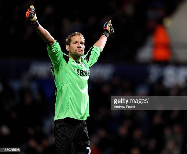 Jussi Jaaskelainen of West Ham United celebrates after Steen Gerrard scores an own goal during the Barclays Premier League match between West Ham...
