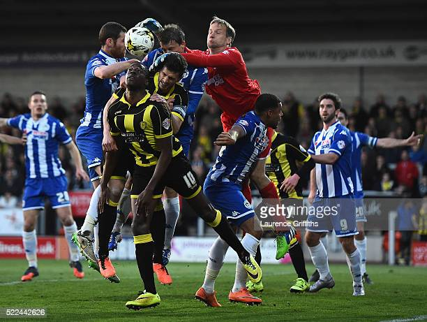 Jussi Jaaskelainen of Wigan punches clear from Lucas Akins of Burton Albion during the Sky Bet League One match between Burton Albion and Wigan...