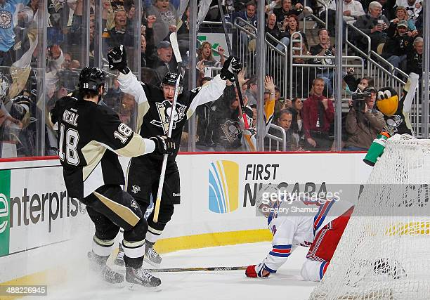 Jussi Jokinen celebrates his goal with James Neal of the Pittsburgh Penguins in front of Marc Staal of the New York Rangers in Game Two of the Second...