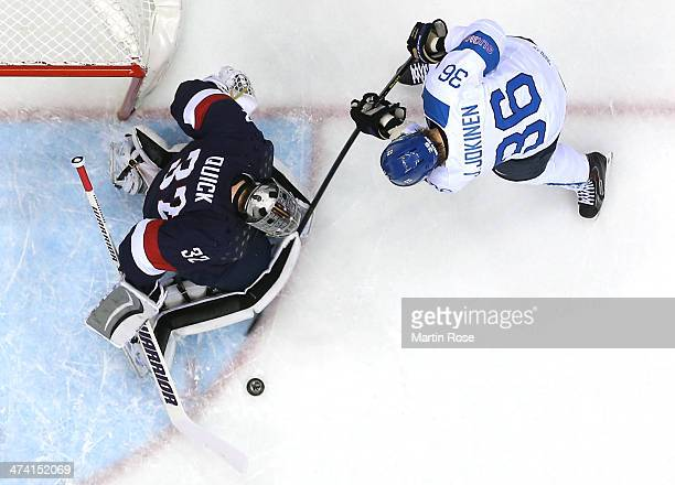 Jussi Jokinen of Finland shoots against Jonathan Quick of the United States in the first period during the Men's Ice Hockey Bronze Medal Game on Day...