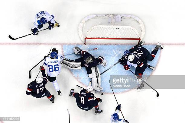 Jussi Jokinen of Finland tries to shoot against Jonathan Quick Ryan Kesler Zach Parise and Ryan McDonagh of the United States during the Men's Ice...