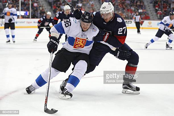 Jussi Jokinen of Team Finland skates past Ryan McDonagh of Team USA in the second period during the pretournament World Cup of Hockey game at Verizon...