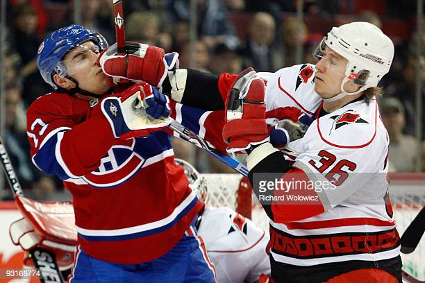 Jussi Jokinen of the Carolina Hurricanes and Mike Cammalleri of the Montreal Canadiens mix it up during the NHL game on November 17, 2009 at the Bell...