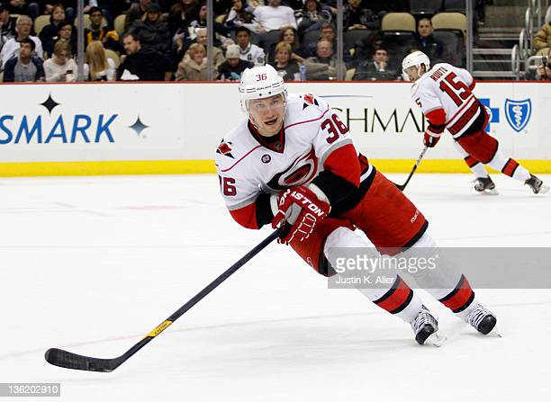 Jussi Jokinen of the Carolina Hurricanes skates against the Pittsburgh Penguins during the game at Consol Energy Center on December 27, 2011 in...