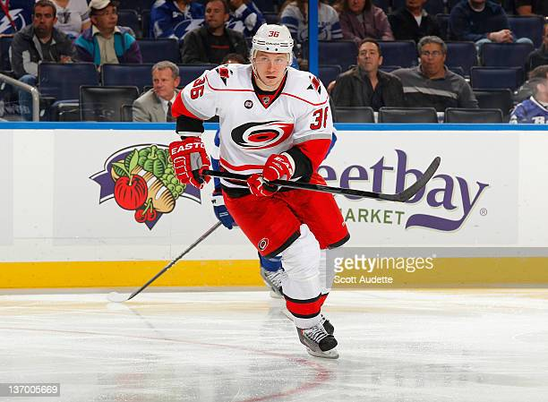 Jussi Jokinen of the Carolina Hurricanes skates to the puck against the Tampa Bay Lightning at the Tampa Bay Times Forum on January 12 2012 in Tampa...