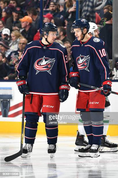 Jussi Jokinen of the Columbus Blue Jackets talks with Alexander Wennberg of the Columbus Blue Jackets prior to the start of the third period of a...