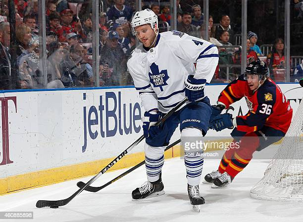 Jussi Jokinen of the Florida Panthers attempts to take the puck from Cody Franson of the Toronto Maple Leafs at the BBT Center on December 28 2014 in...