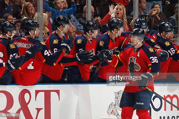 Jussi Jokinen of the Florida Panthers is congratulated by teammates after scoring a second period goal against the Boston Bruins at the BBT Center on...
