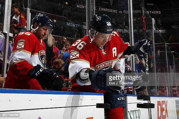 Jussi Jokinen of the Florida Panthers knocks practice pucks onto the ice prior to warm ups against the Montreal Canadiens at the BBT Center on...