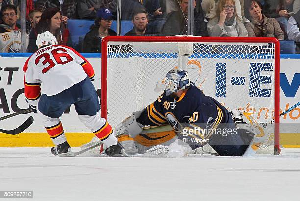Jussi Jokinen of the Florida Panthers scores a first period goal against Robin Lehner of the Buffalo Sabres during an NHL game on February 9 2016 at...