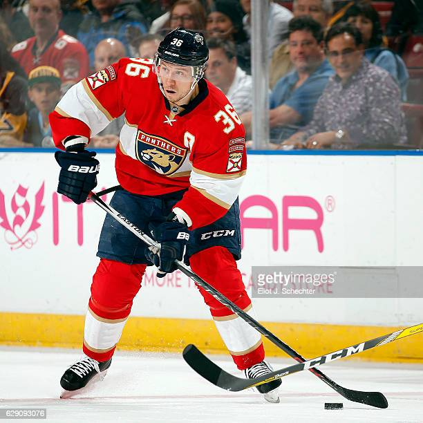Jussi Jokinen of the Florida Panthers skates with the puck against the Pittsburgh Penguins at the BBT Center on December 8 2016 in Sunrise Florida