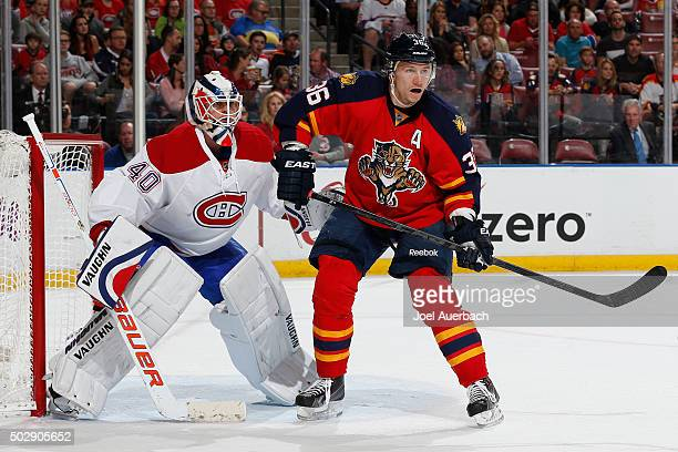Jussi Jokinen of the Florida Panthers takes up position in front of Goaltender Ben Scrivens of the Montreal Canadiens at the BBT Center on December...