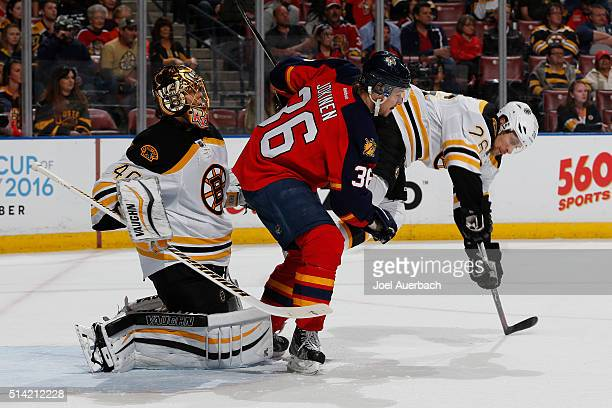 Jussi Jokinen of the Florida Panthers upends John-Michael Liles in front of goaltender Tuukka Rask of the Boston Bruins during first-period action at...