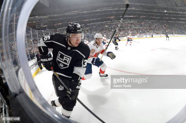 Jussi Jokinen of the Los Angeles Kings battles for the puck against Chase Balisy of the Florida Panthers at STAPLES Center on November 18 2017 in Los...