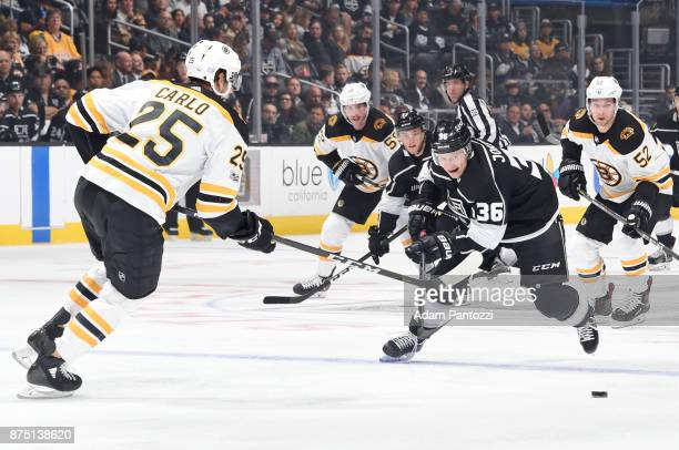 Jussi Jokinen of the Los Angeles Kings chases after the puck against Brandon Carlo of the Boston Bruins at STAPLES Center on November 16 2017 in Los...