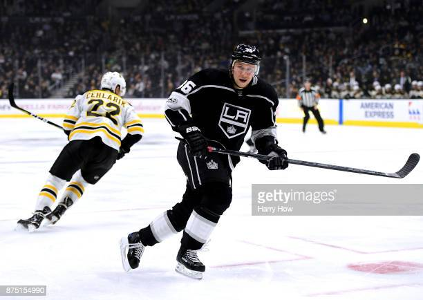 Jussi Jokinen of the Los Angeles Kings in his first game as a King goes after the puck with Peter Cehlarik of the Boston Bruins during the second...